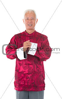 asian  senior chinese man celebrating lunar new year