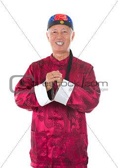 asian  senior chinese man celebrating lunar new year, with tradi