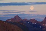 Moon above rocky peaks