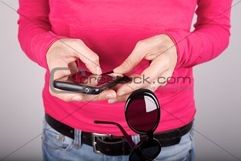 pink woman with smartphoneand sunglasses