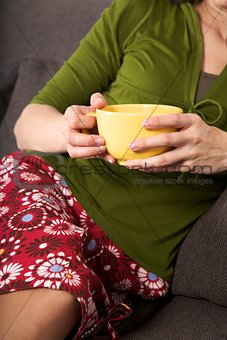 yellow bowl in woman hands