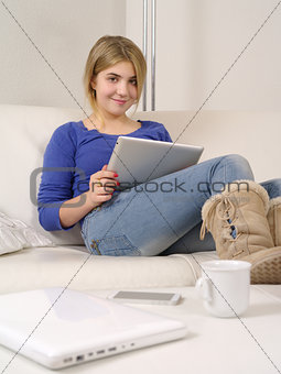 Teenager at home using a digital tablet