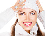 Portrait of beauty woman in white cap and pullover. Happy smile