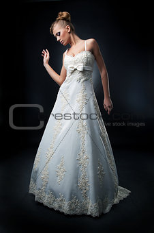 Pretty bride blond hair woman posing in studio