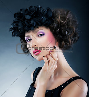 Beautiful young woman with flowers - bright make up