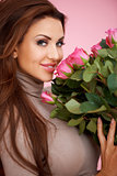 Beautiful seductive woman with roses