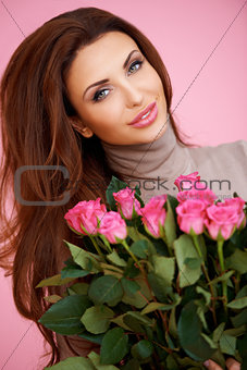 Romantic woman with pink roses