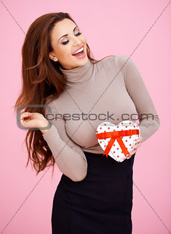 Beautiful woman with her Valentine gift