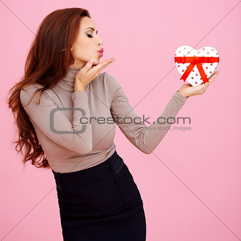 Beautiful woman blowing a kiss