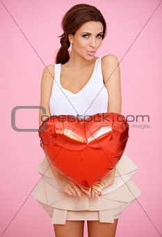 Seductive woman with a red heart