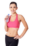 Beautiful female athlete drinking water