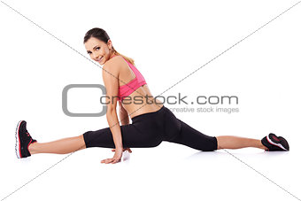 Pretty smiling woman doing the splits