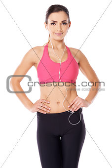 Beautiful athletic woman listening to music
