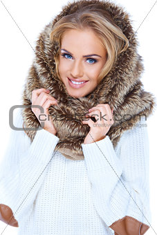 Attractive blond woman wearing fur hood