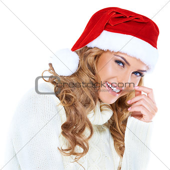 Happy blonde woman with a red Santa hat