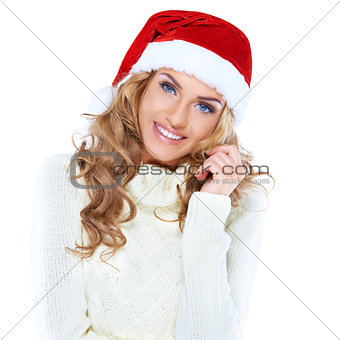 Portrait of a beautiful woman wearing a santa hat