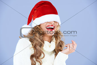 Sexy smiling woman blinded by Red Santa hat