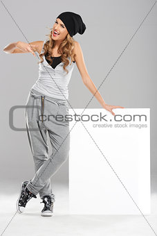 Female modern dancer holding white empty board