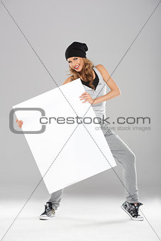 Young fashionable modern dancer holding empty board