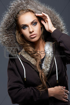 Close up of blond woman wearing hooded sweatshirt