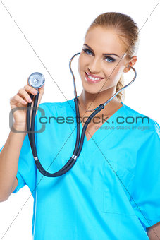 Pretty young doctor holding her stethoscope while isolated