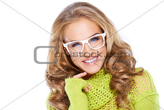 Woman in green warm sweater and white glasses