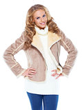 Cute woman wearing modern winter fur jacket