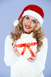 Close up of woman in Santa hat holding Christmas gift