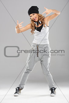 Female modern dancer posing on grey