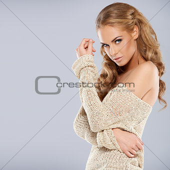 Attractive blonde girl posing while isolated