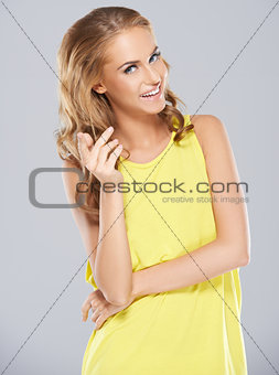 Stylish young woman posing while isolated on a grey