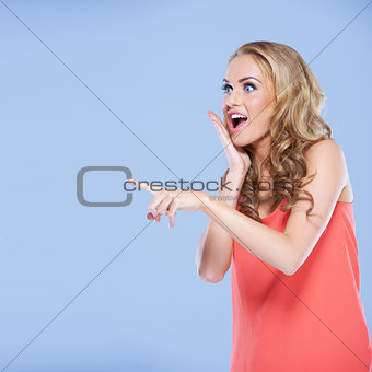 Young woman pointing her finger at something