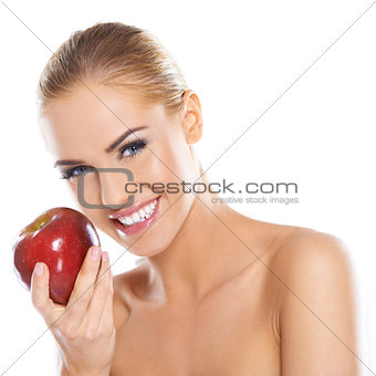 Cute young lady holding red apple