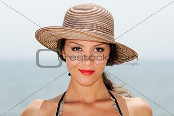 Woman with a sun hat on a tropical beach
