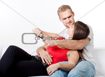 young couple fighting over remote control
