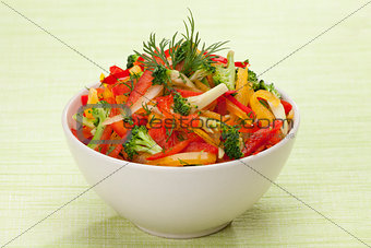 red, yellow and orange sweet pepper, broccoli and fennel salad