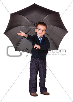 Boy in black clothes standing under umbrella