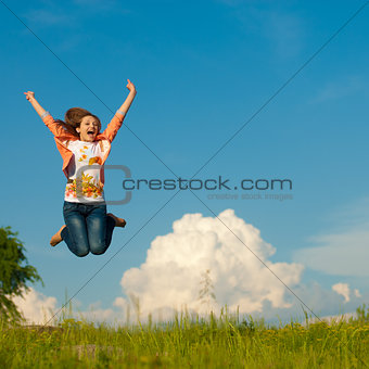 Young pretty woman jumping against blue sky