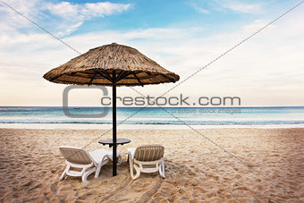Seascape with two chaise longues