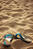 Slippers in sand