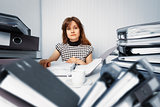 Business woman working in office with documents
