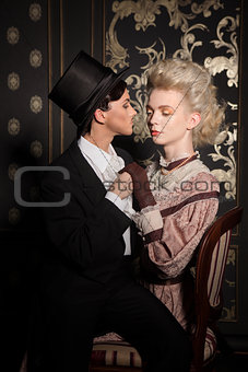 Playful couple in an old-fashioned clothing