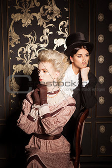 Couple in an old-fashioned costumes posing