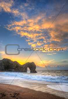 Colourful Winter sunrises behind Durdle Door on Jurassic Coast