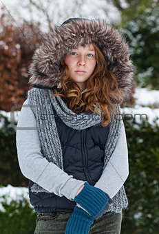 Girl in winter cloths and fur hood