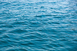 weak ripples on blue water
