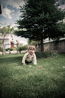 Happy Baby Girl Playing in the Garden