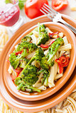 Nutritious pasta with roasted vegetables closeup