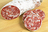 salami in slices on cutting board
