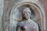 Relief of Woman Head in Siena, Tuscany, Italy